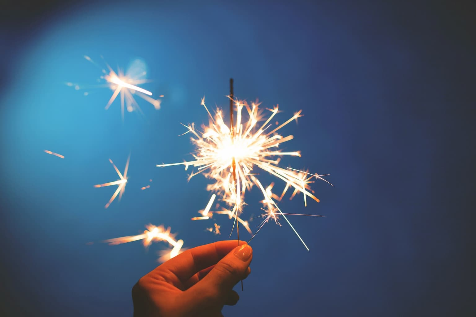 Person holding sparkler that is running out