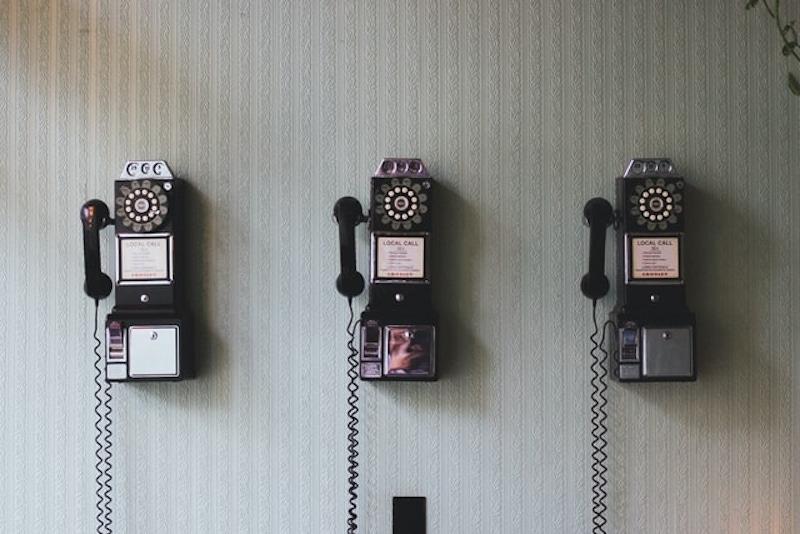 Three rotary payphones phones by Pavan Trikutam on Unsplash